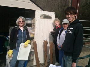 several volunteers cleaning toy shed  wd 2013
